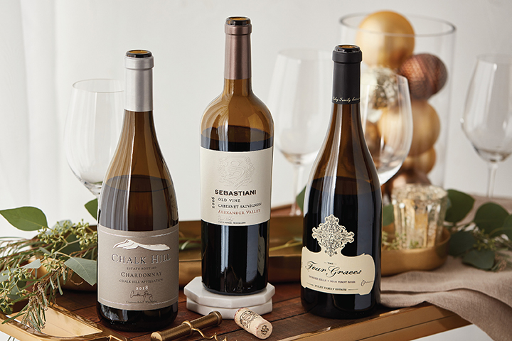 Three Wine Bottles in Holiday Setting