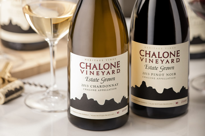 Two Chalone wine bottles and a wine glass