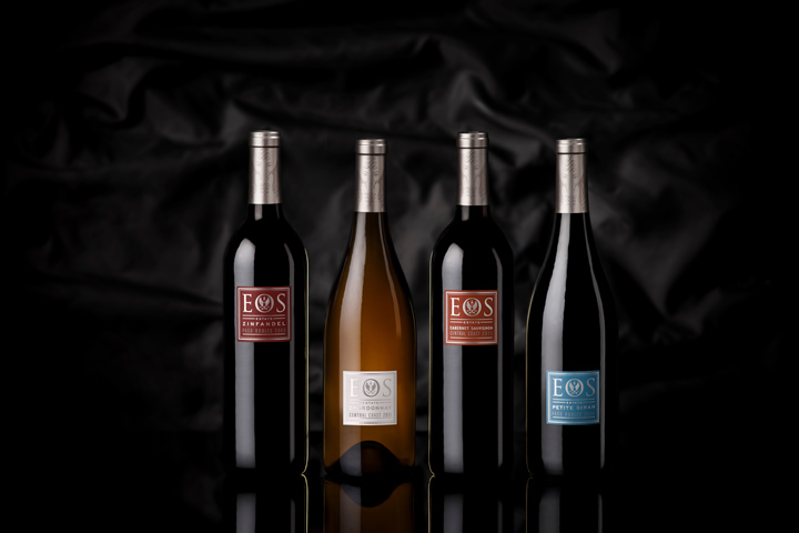 Line-up of 4 Eos wine bottles