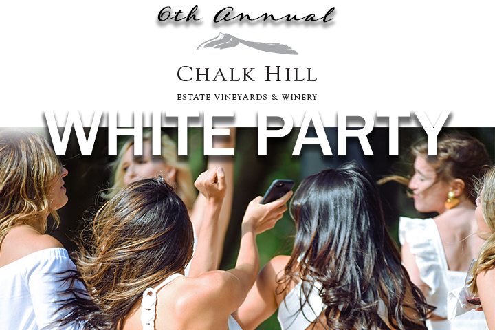 Woman dressed in white dancing at the White Party at Chalk Hill Estate Winery