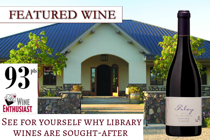 Featured Wine - A wine bottle of 2014 Foley Estates Pinot Noir with the winery in the background
